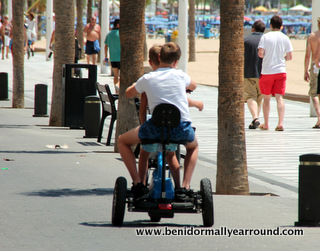 2 boys on scooter